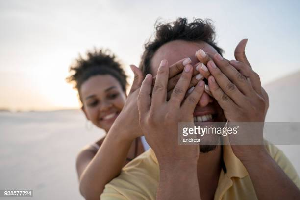 woman surprising her boyfriend at the desert - hands covering eyes stock pictures, royalty-free photos & images