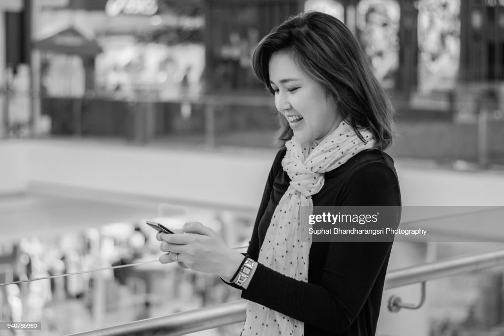 Woman surprising what she found on mobile phone : Stock Photo