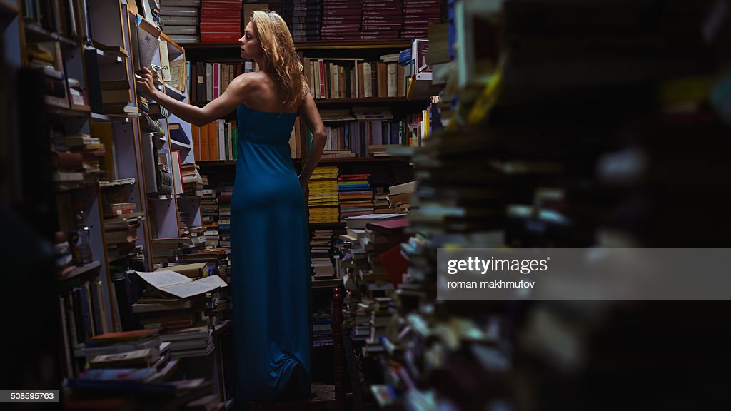 Woman surrounded by books : Foto de stock