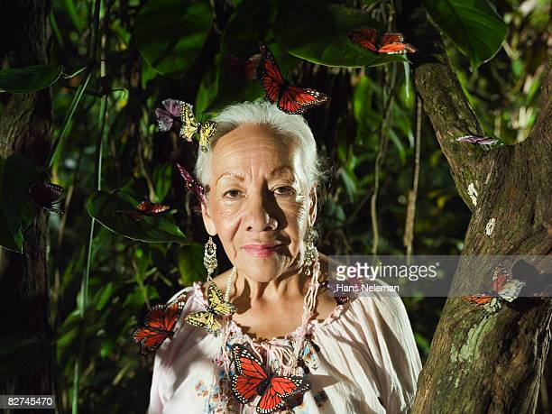 Woman surrounded by butterflies, mother nature