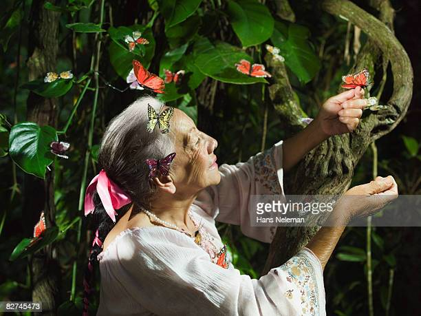 woman surrounded by butterflies, mother nature - las posas stock pictures, royalty-free photos & images