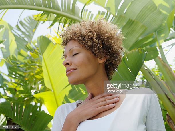 Woman surrounded by palm fronds