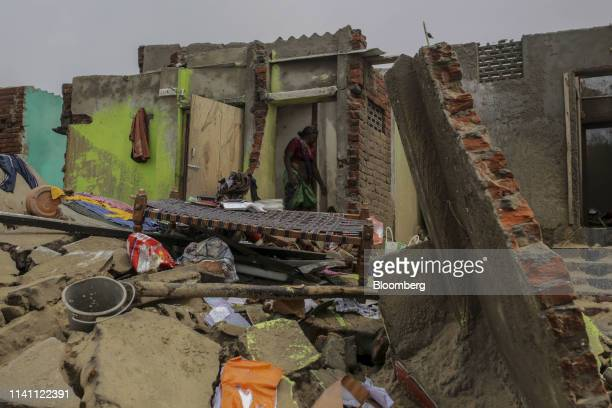 A woman surveys a damaged home after Cyclone Fani passed through Puri Odisha India on Saturday May 4 2019 A category 4 storm with strong wind and...