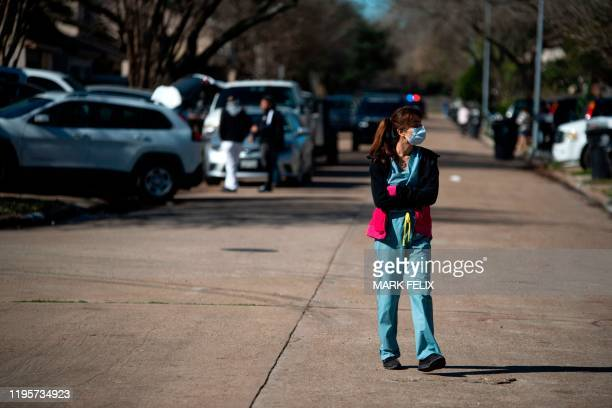 A woman surveys the damage in her neighborhood after an explosion at a northwest Houston Texas manufacturing business on January 24 2020 A large...
