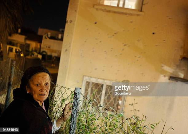 Woman surveys the damage to a house following a Palestinian rocket attack in Sderot, Israel, on Sunday, Jan. 4, 2009. Israel said its nine-day...