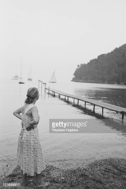 A woman surveys the view from Paraggi Beach near the tourist resort of Portofino Italy August 1952 Original Publication Picture Post 6023 unpub