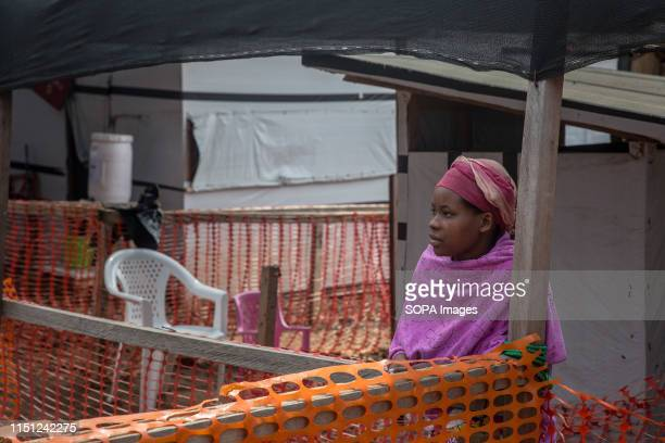 A woman suspected of having Ebola stands in the isolation area of the Ebola treatment centre in Beni eastern Democratic Republic of the Congo The DRC...