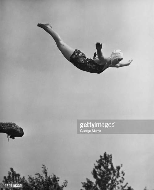 woman swan diving - diving sport stock pictures, royalty-free photos & images
