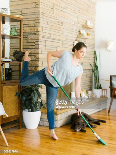 woman sweeping and dusting - multi tasking stock pictures, royalty-free photos & images