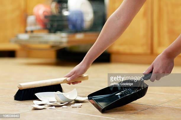 woman sweeping broken cup - dustpan and brush stock pictures, royalty-free photos & images