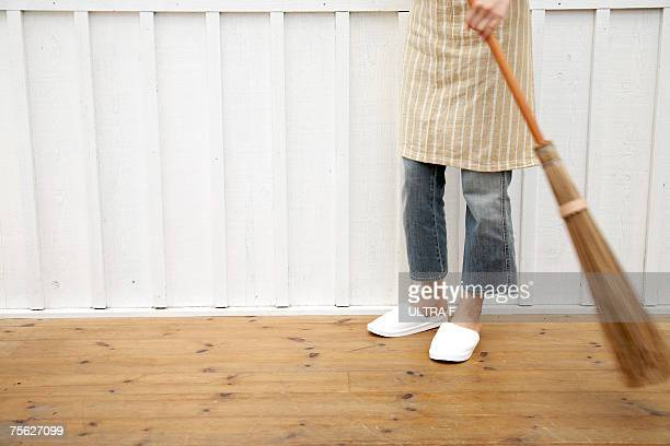 woman sweeping floor using japanese style broom in home - broom sweeping stock pictures, royalty-free photos & images