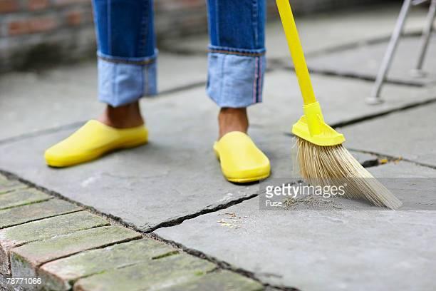 Woman Sweeping Patio