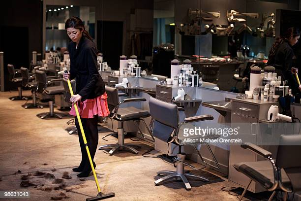 Woman sweeping up at the end of the day
