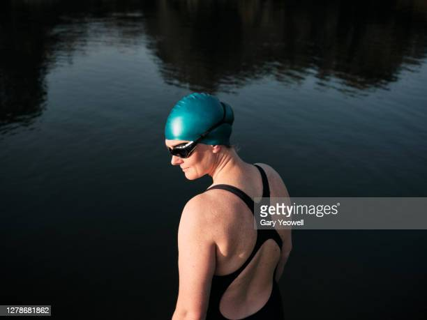 woman swimmer standing by a river - swimming stock pictures, royalty-free photos & images