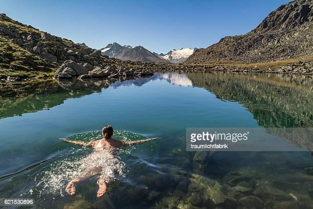 woman swimming in a clear alpine lake