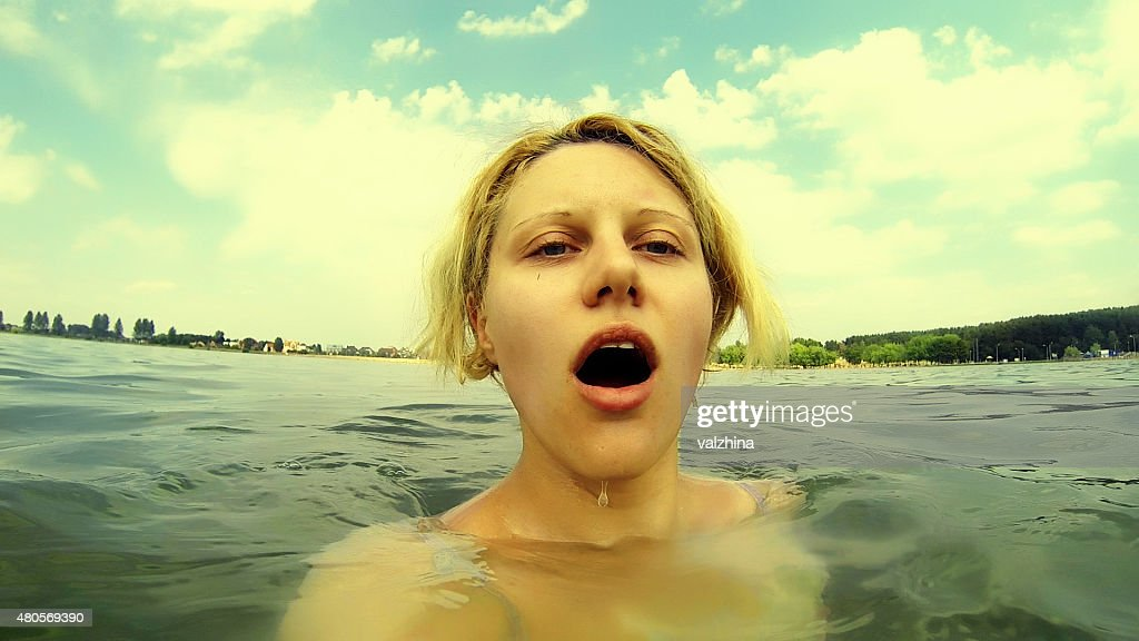woman swimming in a lake : Stock Photo