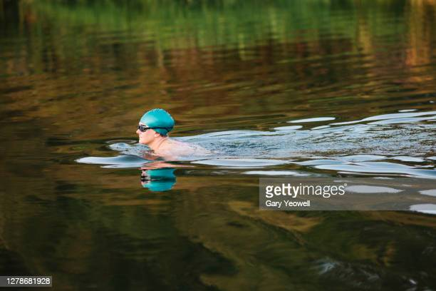 woman swimming in a river - swimming stock pictures, royalty-free photos & images