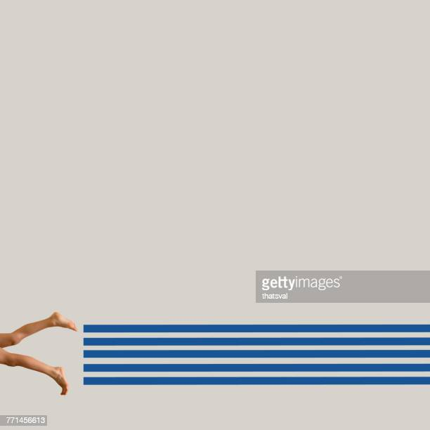 woman swimming in conceptual swimming pool - same action stock photos and pictures