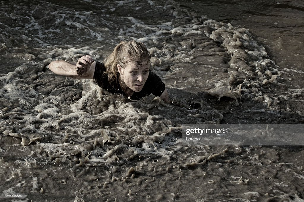 Woman Swimming In Dirty Water Stock Photo - Getty Images