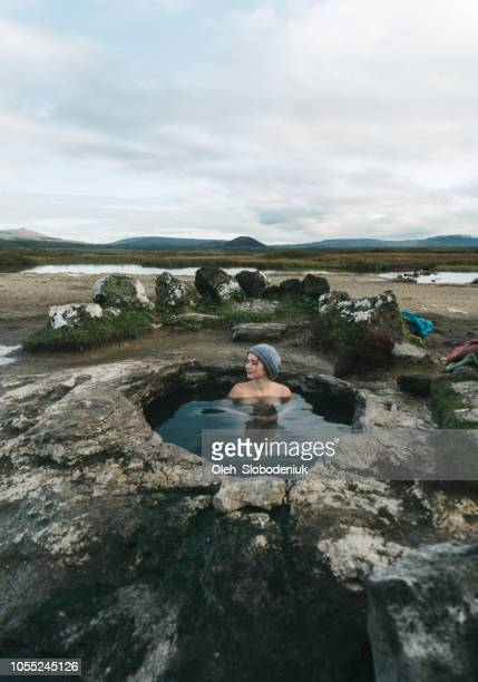 woman swimming  in hot pool in iceland - hot spring stock pictures, royalty-free photos & images