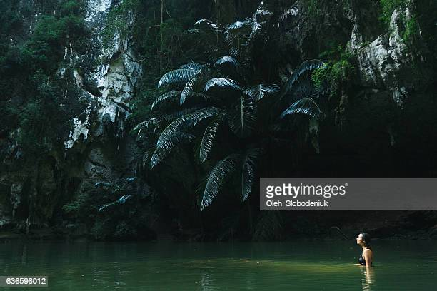 Woman swimming in lagoon