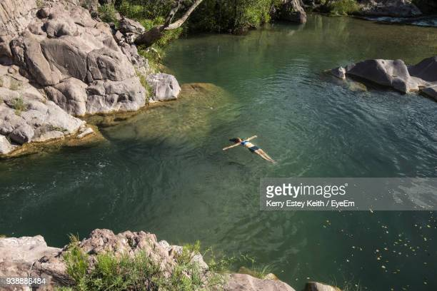 woman swimming in lake - kerry estey keith stock photos and pictures