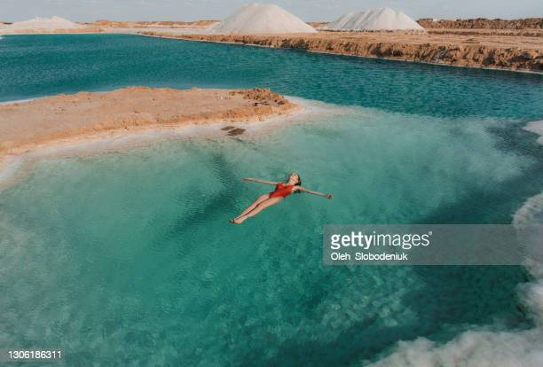 woman swimming in salt lake  in siwa oasis - egypt stock pictures, royalty-free photos & images