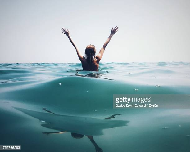 Woman Swimming In Sea