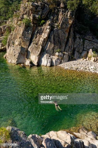 woman swimming in solenzara river - corcega fotografías e imágenes de stock
