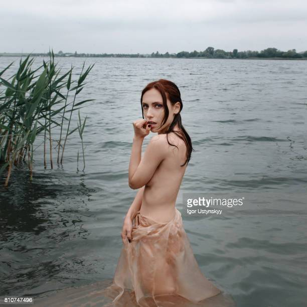 Woman swimming in the lake naked
