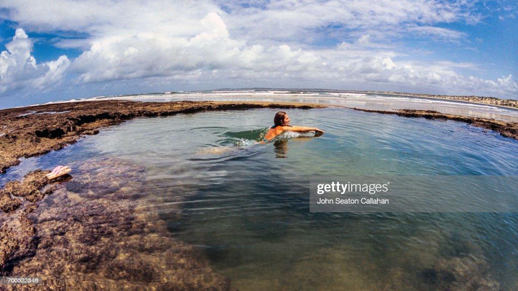 Woman Swimming in Tide Pool on Manda Island : Stock Photo