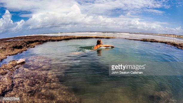 woman swimming in tide pool on manda island - mombasa stock photos and pictures