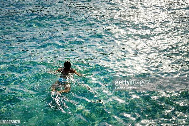 woman swimming in tropical sea - terengganu stock pictures, royalty-free photos & images