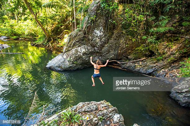 A woman swimming in tropical water.