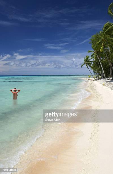Woman swimming in tropics