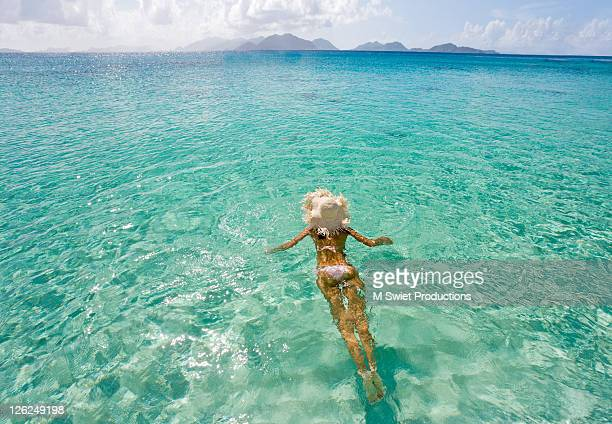 Woman swimming on tropical vacation in Caribbean