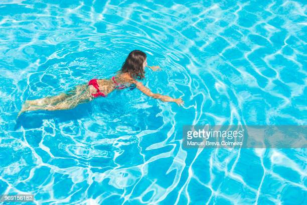 woman swimming - bikini top stock pictures, royalty-free photos & images