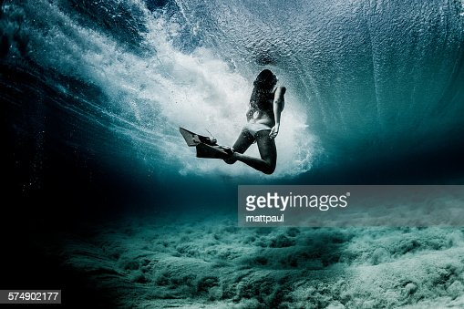 Woman swimming underwater with flippers, Hawaii