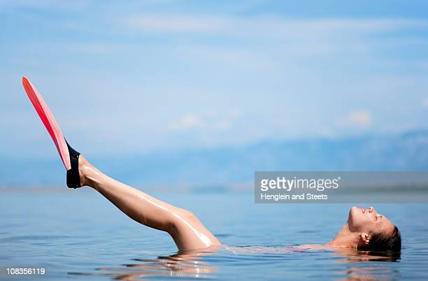 Woman swimming with flippers at beach