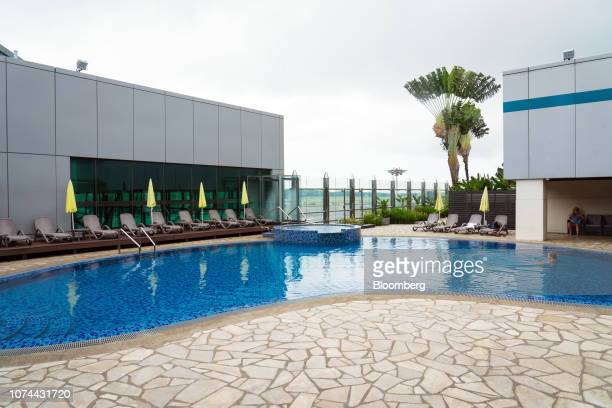 A woman swims in a pool at Terminal 1 of Changi Airport in Singapore on Thursday Dec 13 2018 Singapore'sChangiAirport votedtheworld's bestfor...
