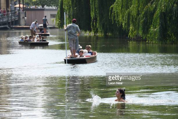 A woman swims in the River Cam on July 25 2019 in Cambridge United Kingdom The Met Office issued a weather warning from 3pm this afternoon They warn...