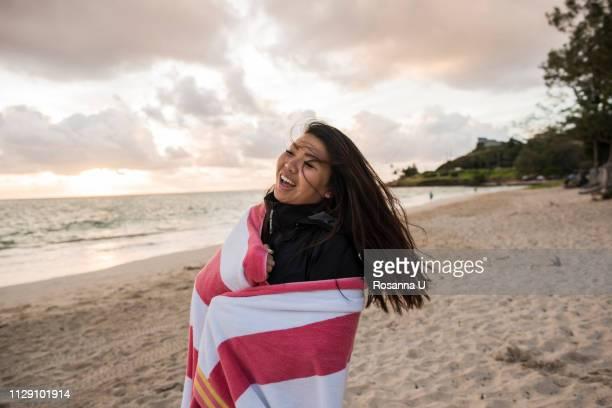 woman swinging hair, kailua beach, oahu, hawaii - kailua stock pictures, royalty-free photos & images