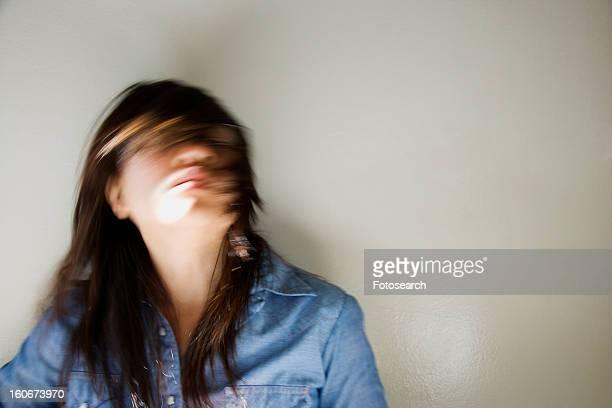 Woman swinging head and hair around