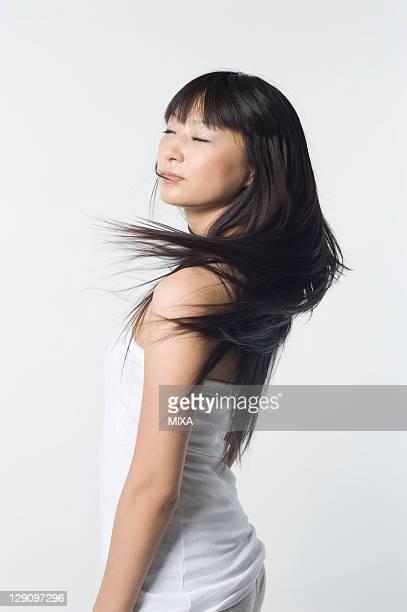 Woman Swinging Long Hair
