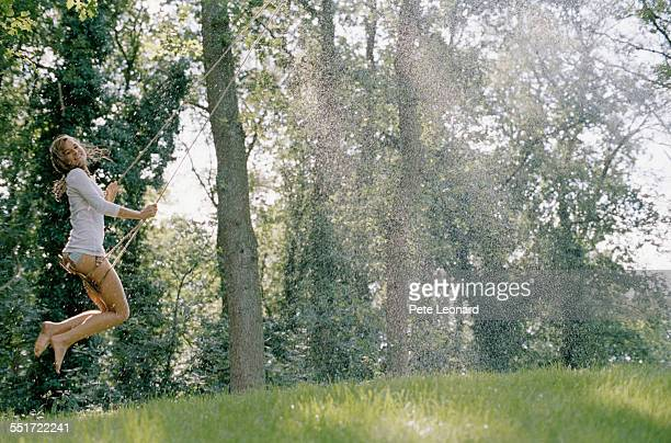 Woman Swinging Outdoors