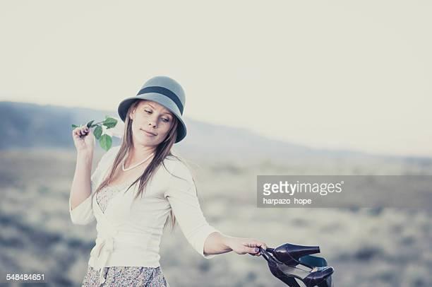 woman swinging shoes - hope imagens e fotografias de stock