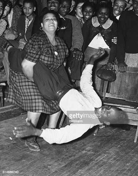 A woman swings her jitterbug partner by the legs during a Salvation Army benefit dance marathon in Los Angeles