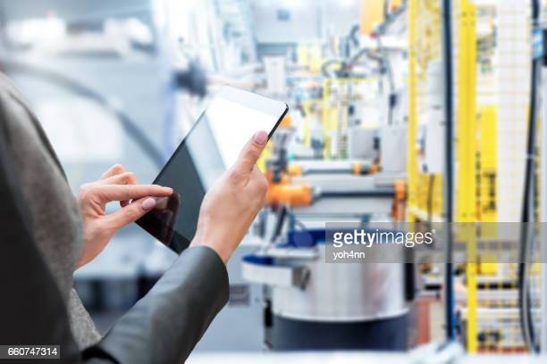 Woman & Tablet & Robotic smart machines