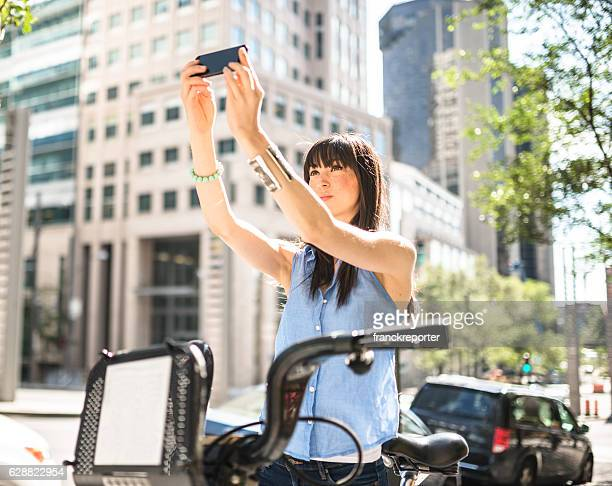 woman take a selfie and using the bicycle in Montreal