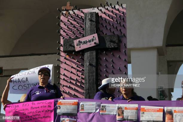 Woman take part in the commemoration of International Women's Day at the international border in Ciudad Juarez Chihuahua state Mexico on March 8 2017...